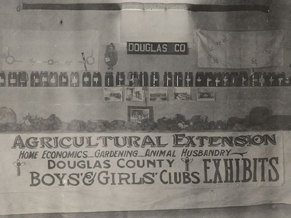 Historic photo of a fair exhibit of fresh and canned produce