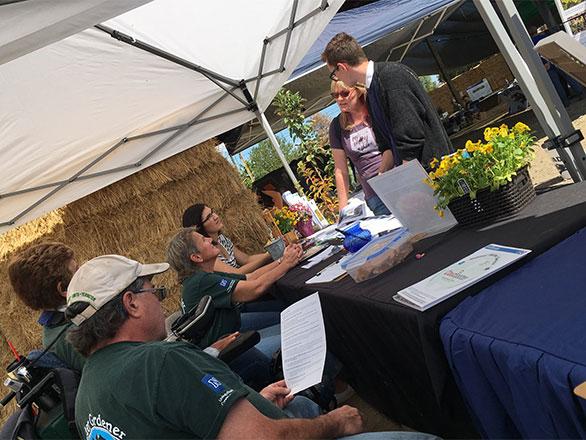 Master Gardener Volunteers helping people at Nevada Field Day