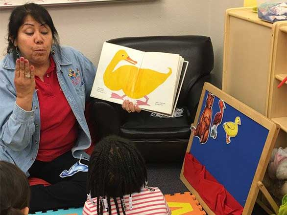 child care provider reading to young children